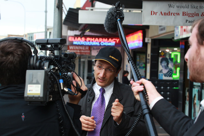 "Jonar Nader outside Elias Pharmacy in Fairfield, preparing background footage for his new Documentary called ""BLUNDER : GOVERNMENT (HAIR) STYLE""."